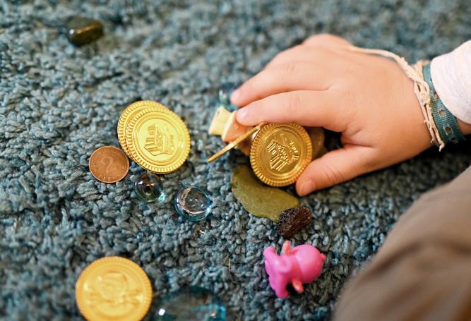 Baby Münzen Hand